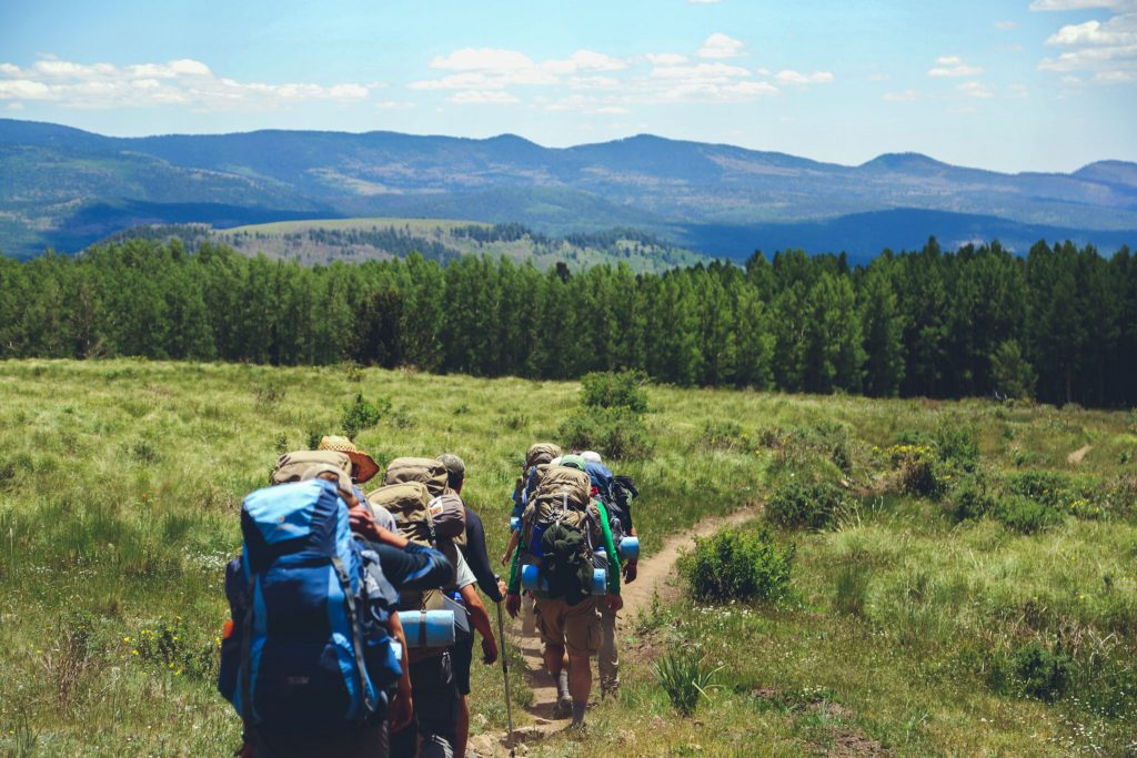 group of hikers walking on the path karkonosze mountains